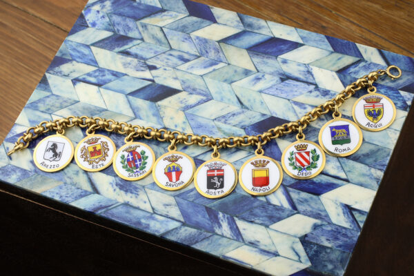 A Gold And Enamel Charm Bracelet
