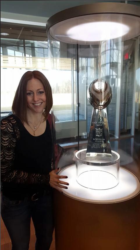Lindsay B. Coleman with Superbowl trophy