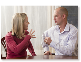 two adults using sign language