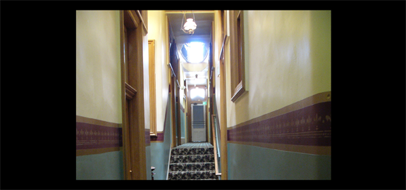 Hallway at the Silver Queen Hotel in Virginia City, Nevada, where ghostly footsteps and voices are often heard by guests during the late night hours. (staff photo)