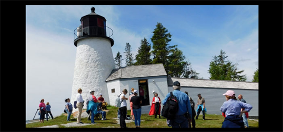 A Red Cloak Tour group explores Burnt Island Lighthouse and the surrounding buildings on a special excursion. (staff photo)