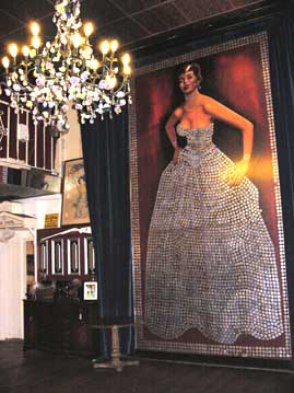 Namesake of the hotel, the Silver Queen, clad in a dress made from silver dollars and on display in the saloon. (staff photo)