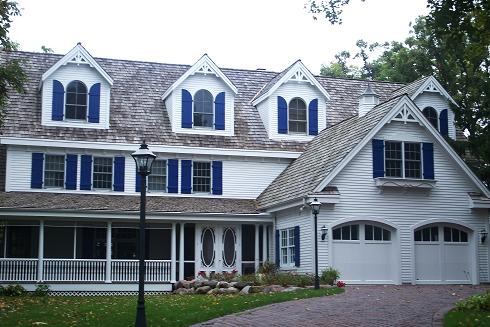 Residential House Painted White with Colored Trim and Shutters