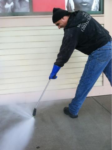 Pressure washing sidewalk 2