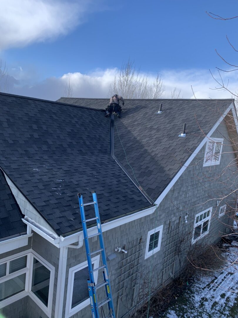 Roofing installation with ladder