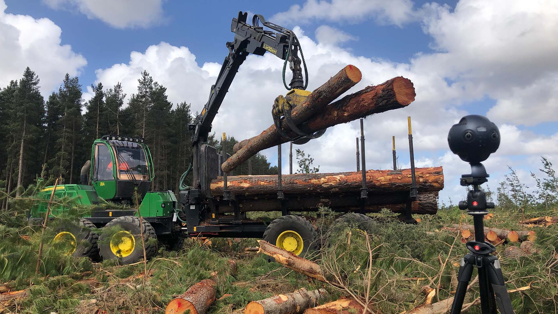 Logs being lifted next to Insta360 Pro camera filming for Forest Learning 360 video production