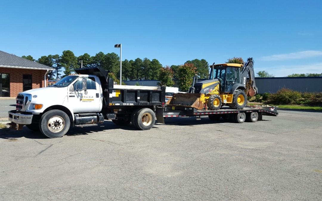 Firstcall Environmental Dump Truck with Backoe