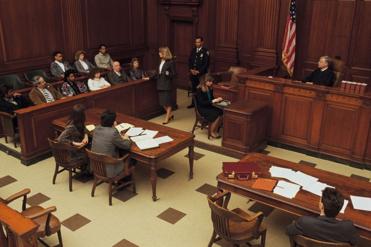 Courtroom scene with lawyer arguing before jury.