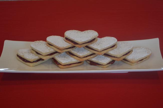 A plate of Heart-Shaped Sandwich Sugar Cookies