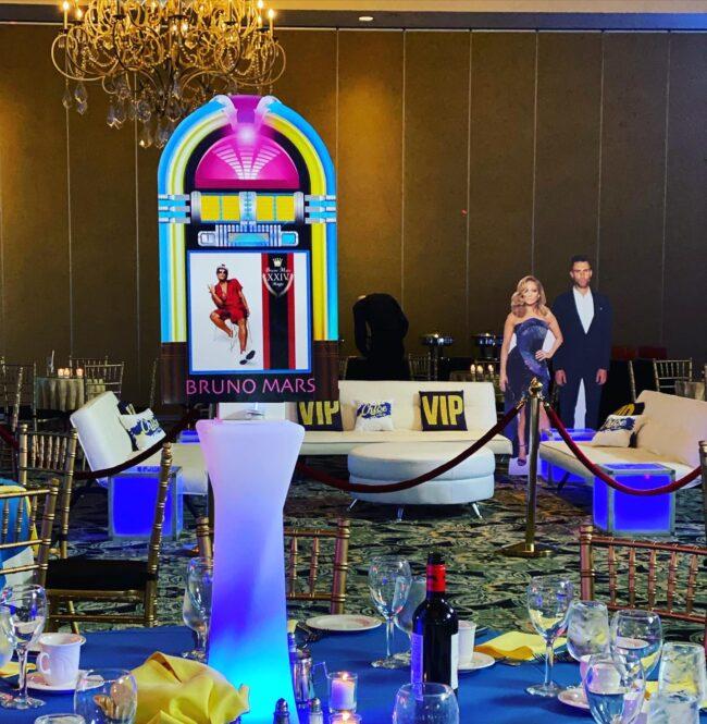 VIP area. Adam Levine, Jennifer Lopez cardboard cutouts.