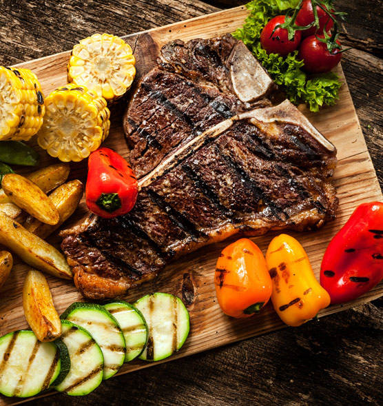 Grilled Steak and Vegetables resting on a cutting board.