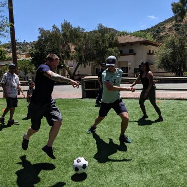 Some AV-ators playing soccer at the 2019 company picnic.