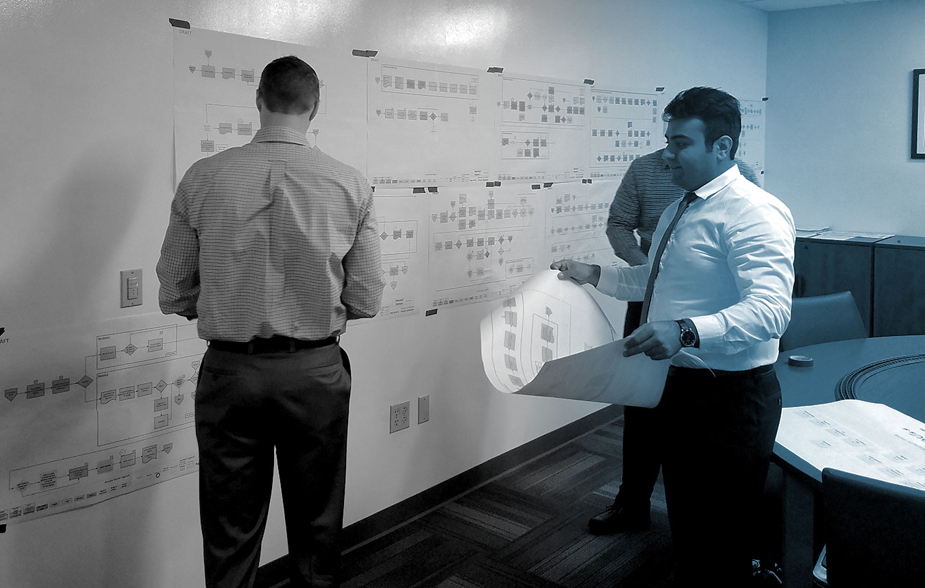 Alta Vista employees conduct value stream mapping for business process improvement on the DEA project