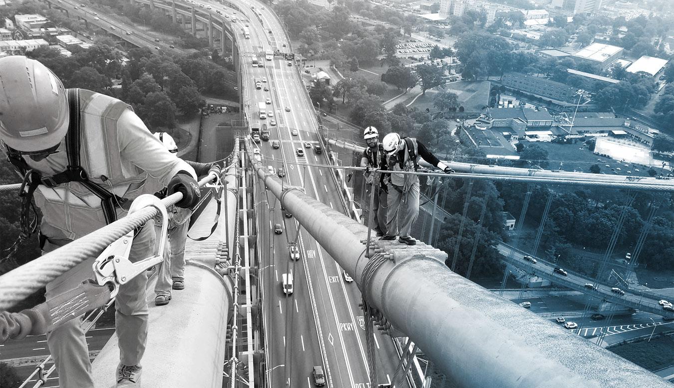 Inspectors climb bridge cables during a bridge inspection for the TBTA