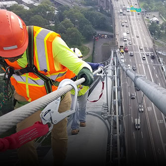An Alta Vista inspector climbs bridge cables during an inspection. Click for more information on the TBTA bridge inspections.