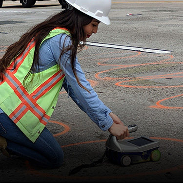 An employee using ground-penetrating radar (GPR). Click for more info on our local agency work