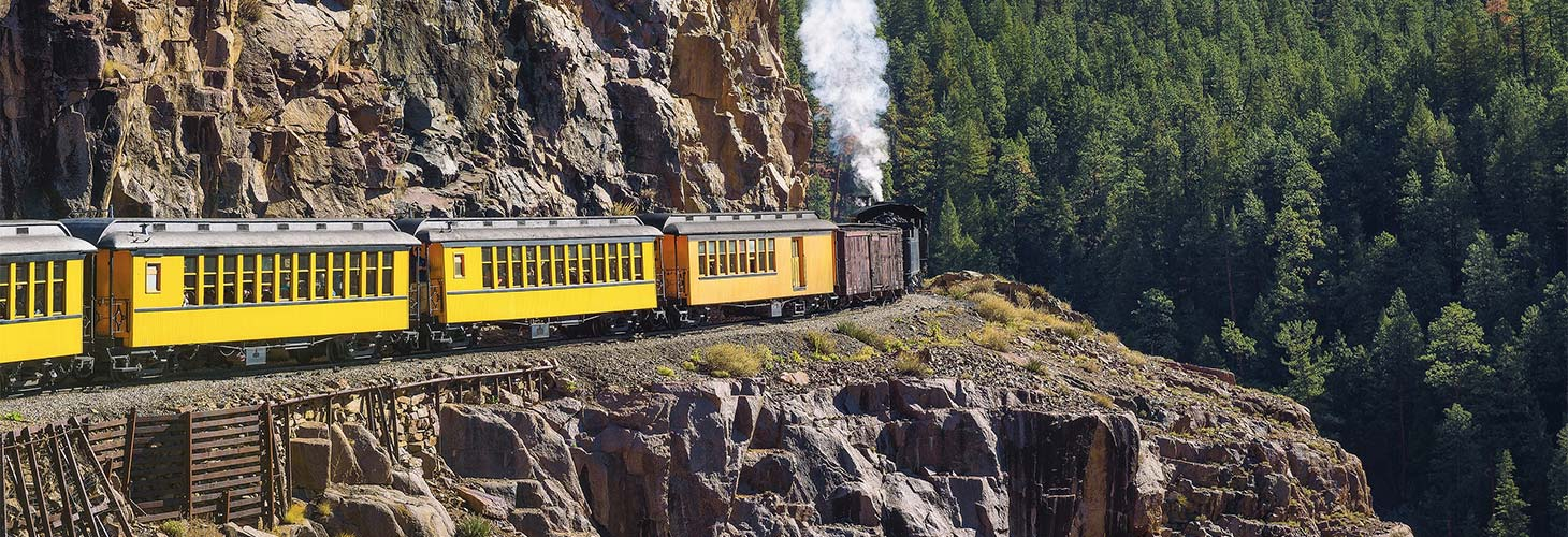 Historic steam train on a mountain pass