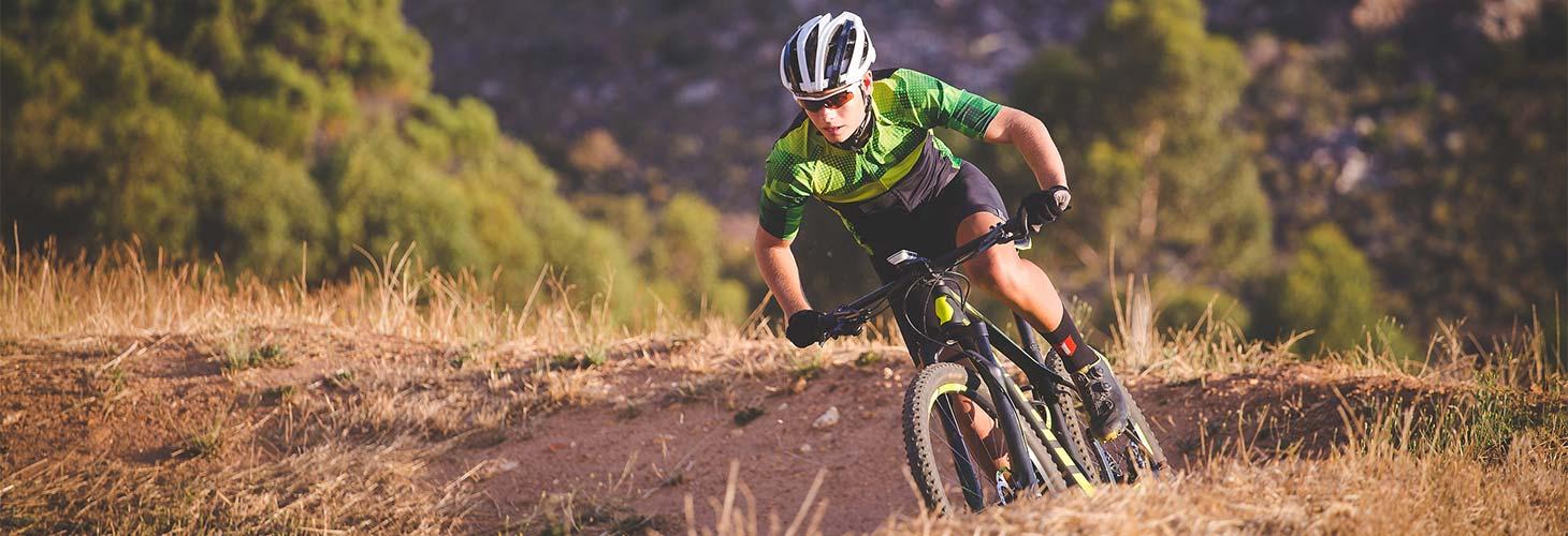 Man riding a mountain bike off road