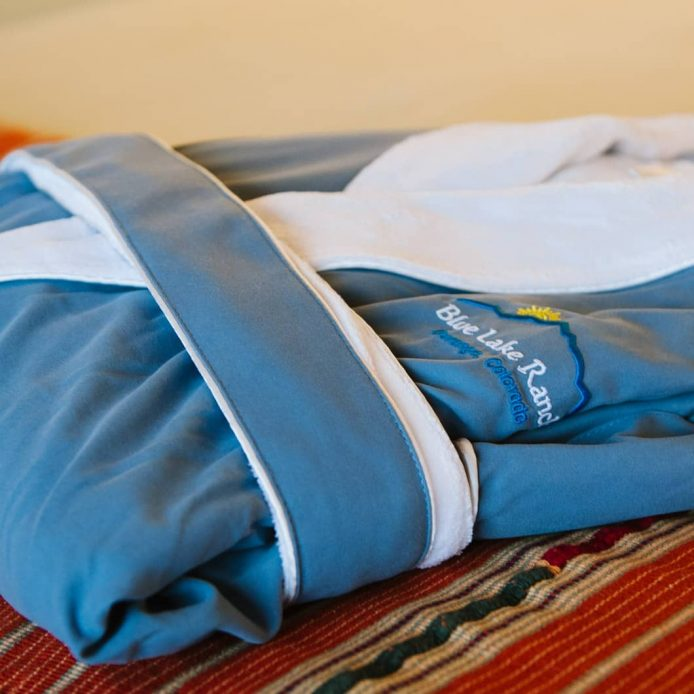 Blue and white robe with Blue Lake Ranch embroidered on the left side