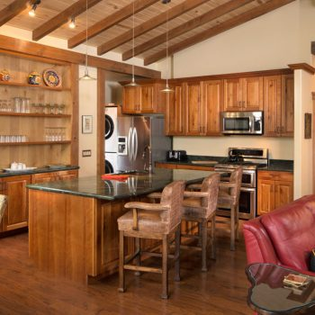 cozy colorado lodging with kitchen with wood cabinets