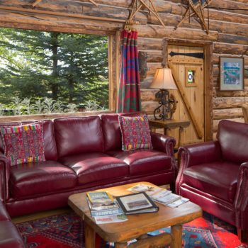 cozy cottage style colorado lodging with burgundy sofa