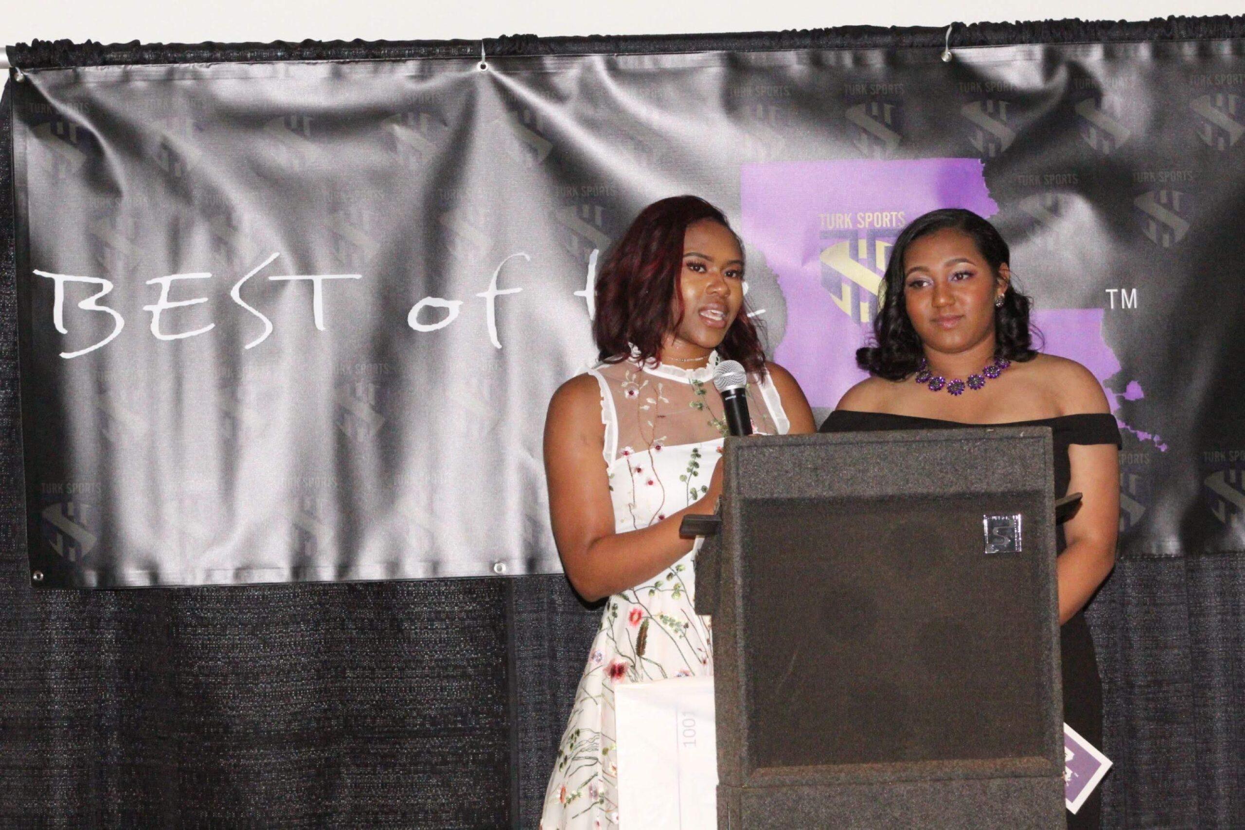 Hailey King & Amari Hurst present the award best defensive athlete- Football