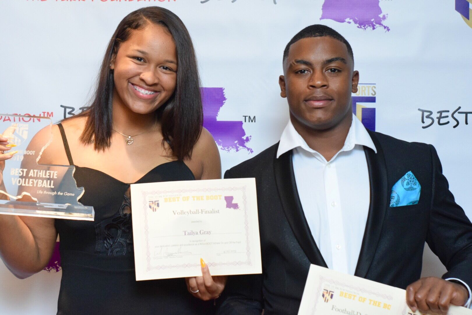 Warren Easton's Tail'ya Gray & Jacob Parker show off their awards.