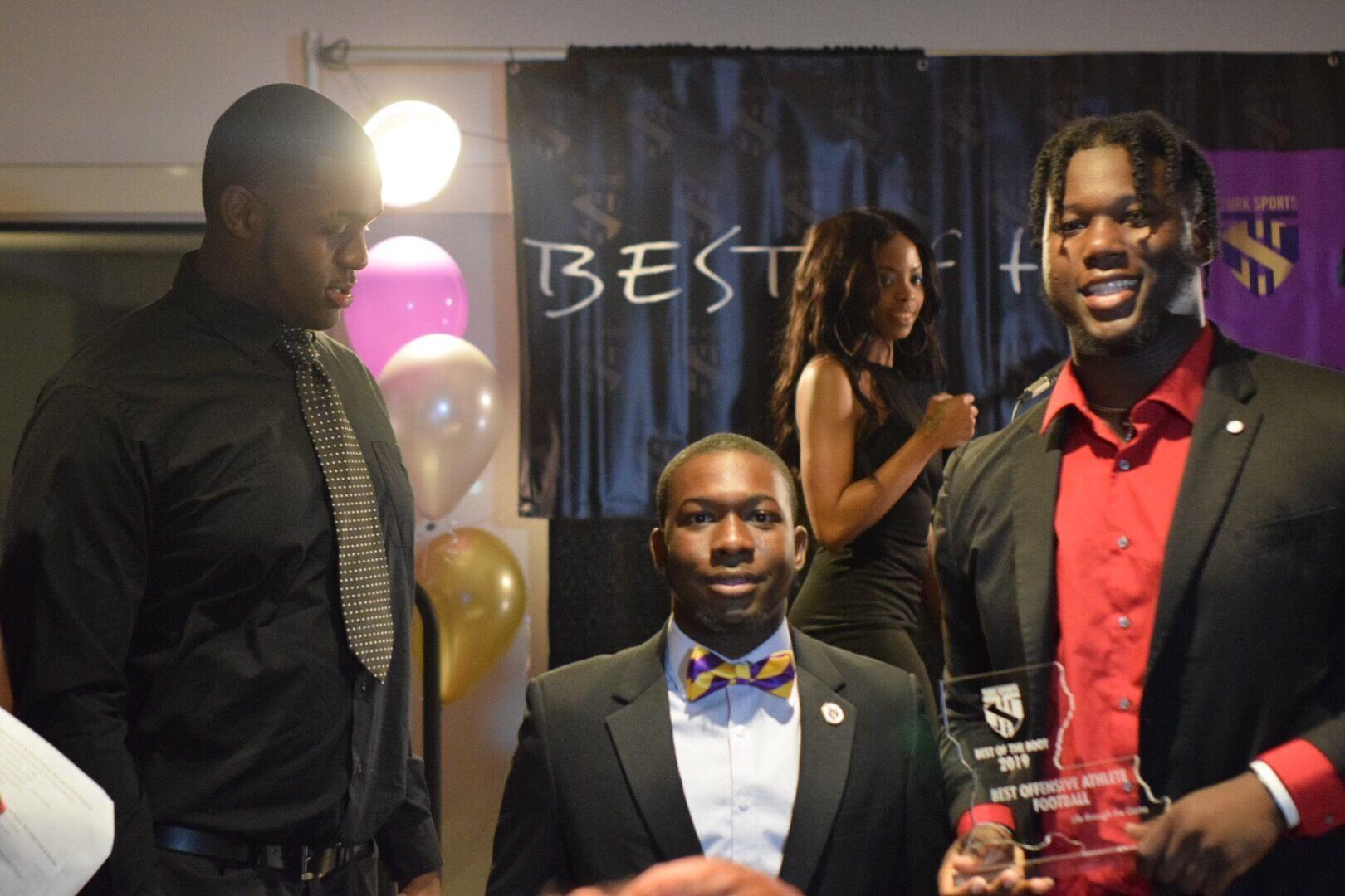 Sedrick Van Pran- Best Offensive Athlete, Football receives award from Kaleb Etienne & Lance Jones