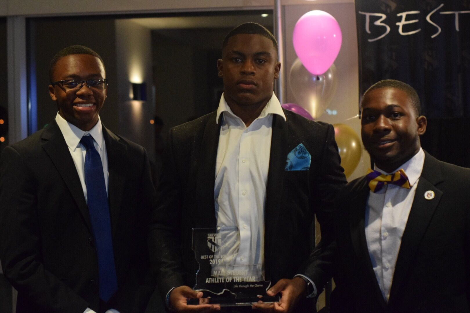 Jacob Parker- Male Student-Athlete of The Year receives award from Myles Mackie & Lance Jones