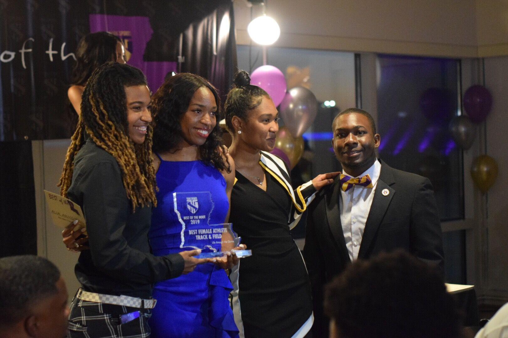 Alia Armstrong- Best Female Athlete; Track & Field receives award from Pro Track Star Aliah Hobbs, presenter Amaya Cannon & Lance Jones