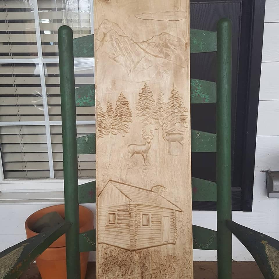 custom 3d carving of a mountain scene for a cabinet