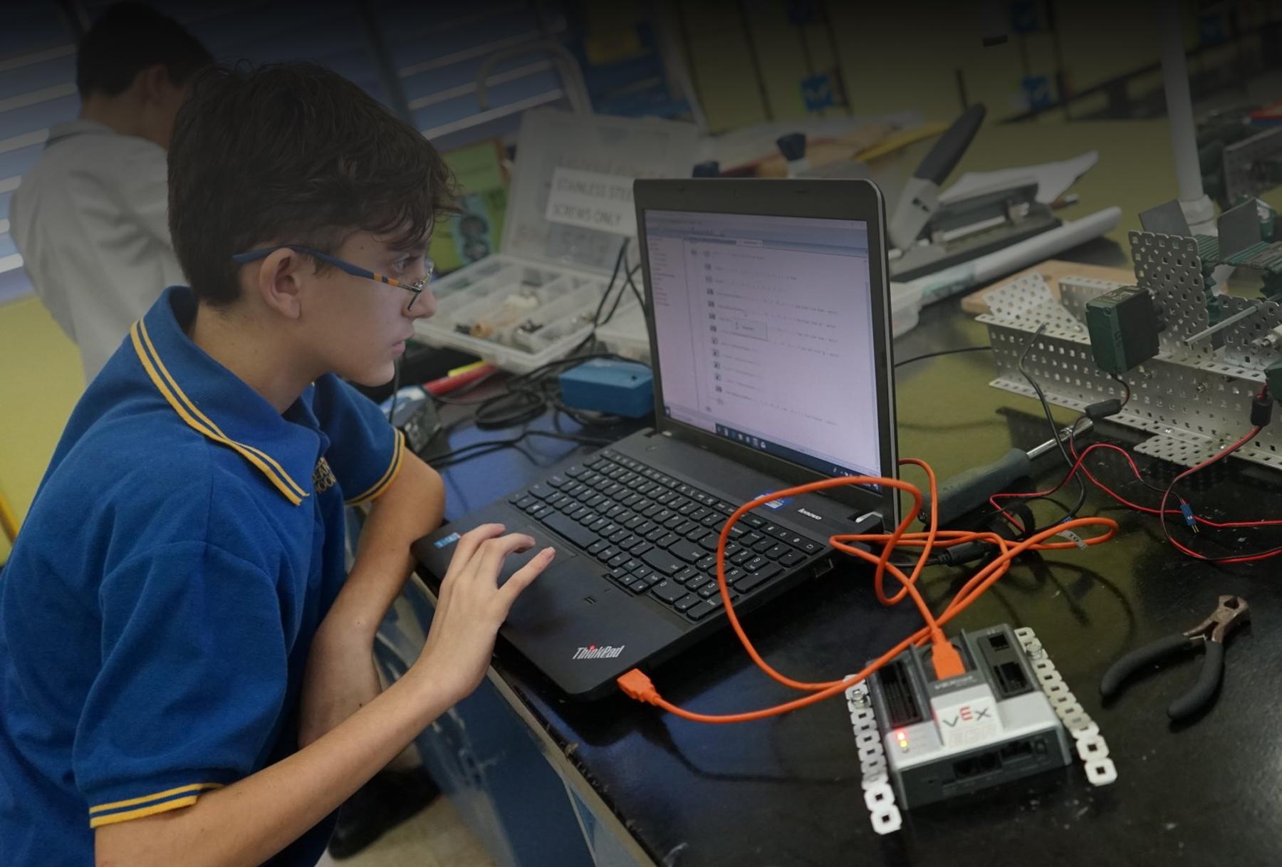 Robotics student using computer
