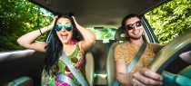 happy couple in new car after selling junk car