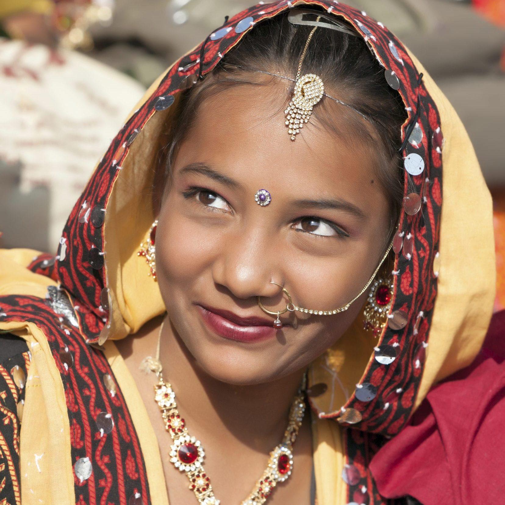 PUSHKAR, INDIA - NOVEMBER 21: An unidentified girl  in colorful ethnic attire attends at the Pushkar fair on November 21, 2012 in Pushkar, Rajasthan, India.
