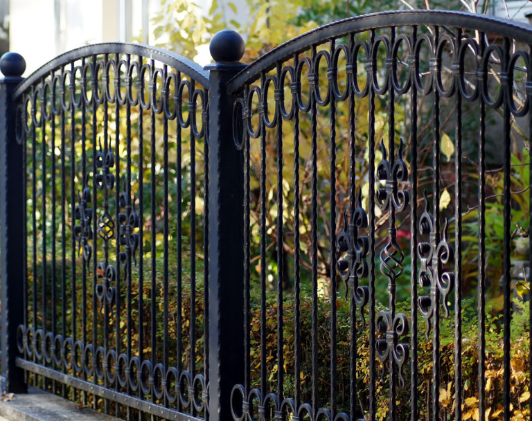 Iron Fence on side of business