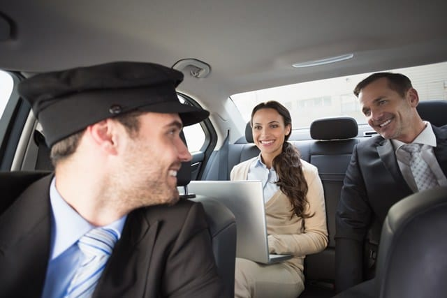 crown prestige limousines chauffeured corporate transfer, driver welcoming clients