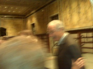 This grainy photo is Alan Alda working the room-trust me.
