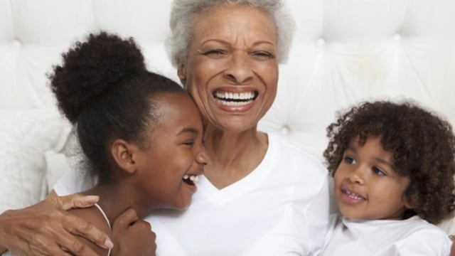 an older woman with two young kids