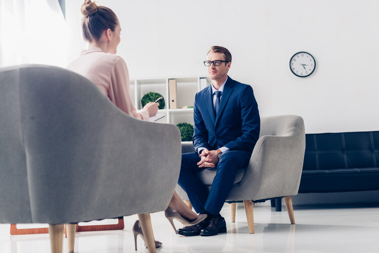 an interview setting between a woman and a man
