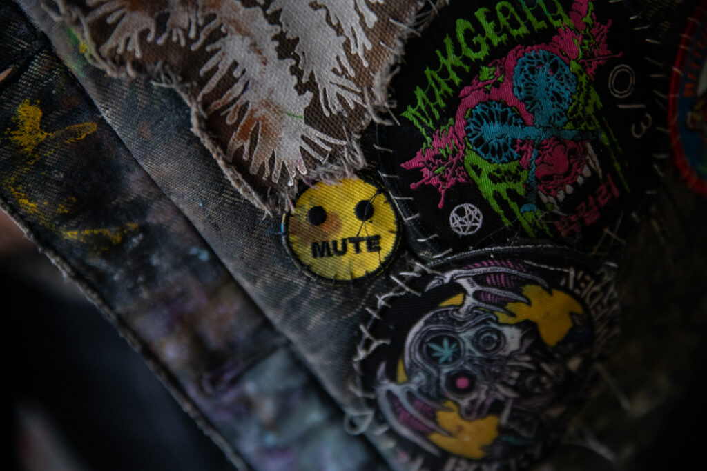 """hand sewn patch that says """"mute"""" on it"""
