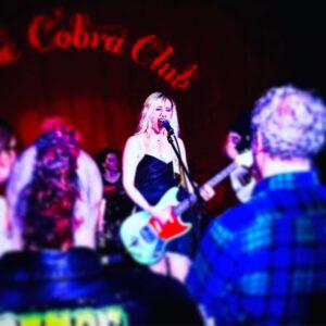 Teenage Whores performing