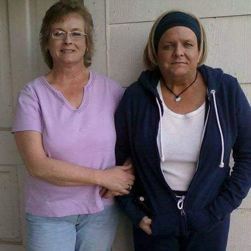 Louise Cook 770-BAM-Tree employee on the right standing next to her sister