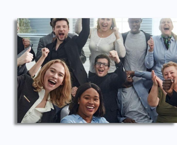 A diverse workforce celebrate together.