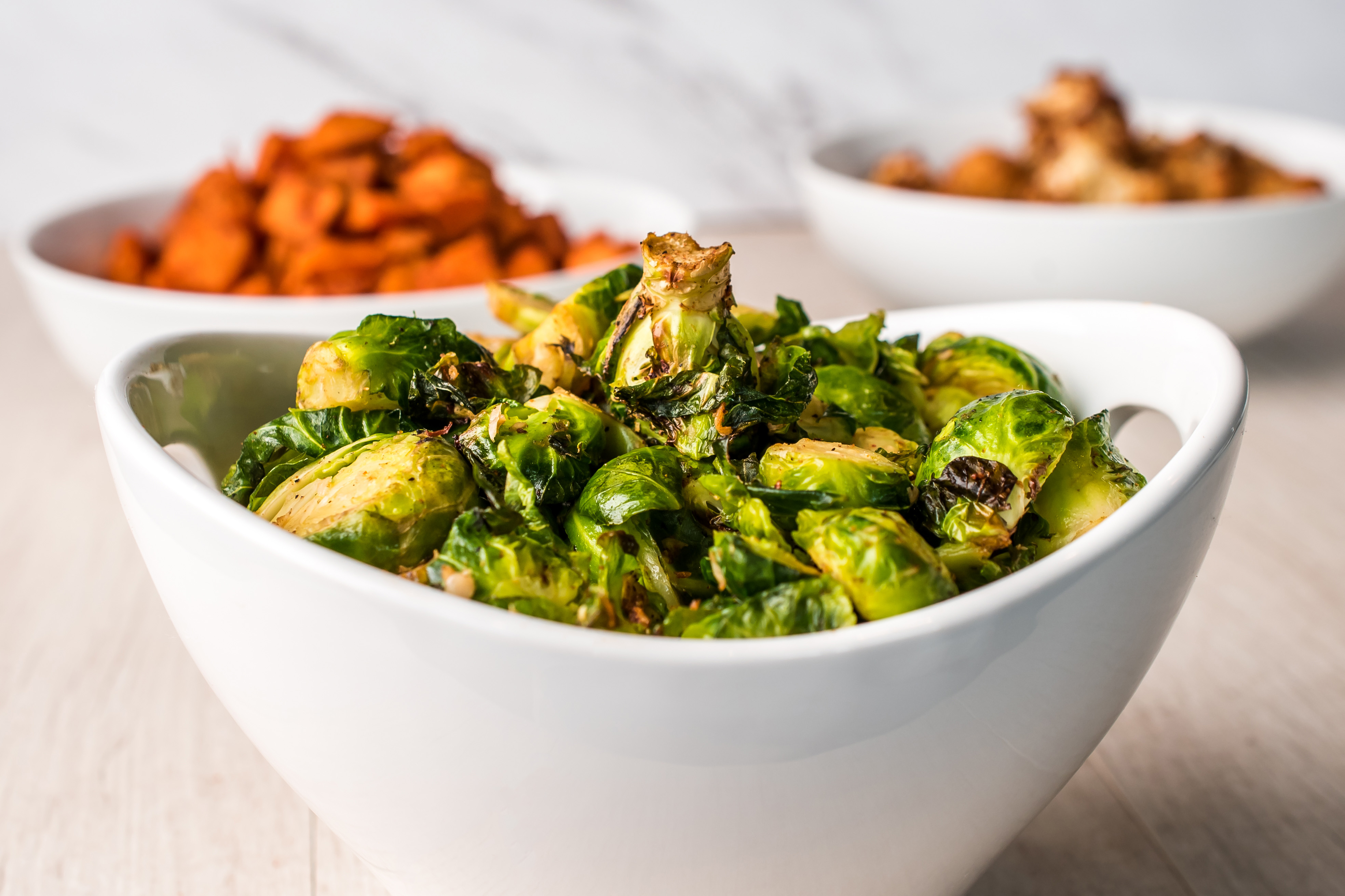 a bowl of brussels sprouts a good side dish with tofu