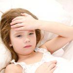 sick kid in bed