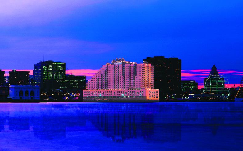 Dockside building at night against Philadelphia skyline