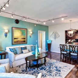 Condo interior at The Residences at Dockside. Lovely living room with blue and tan walls.