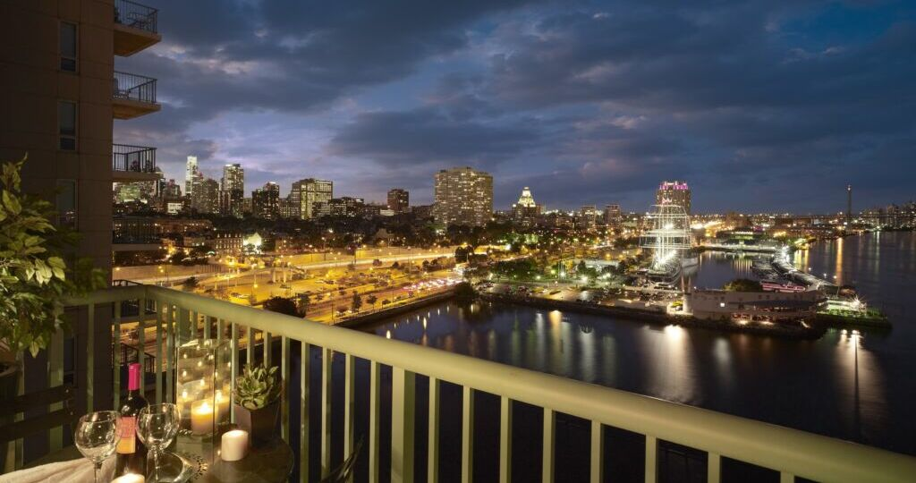 View from private terrace overlooking Penn's Landing and Philly Skyline at Night.