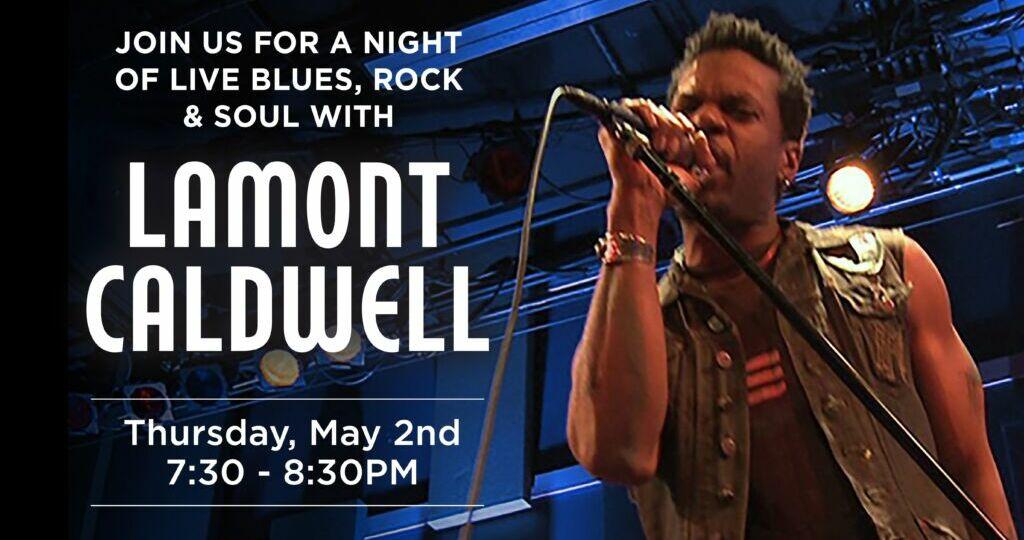 Lamont Caldwell singing on blue light stage.