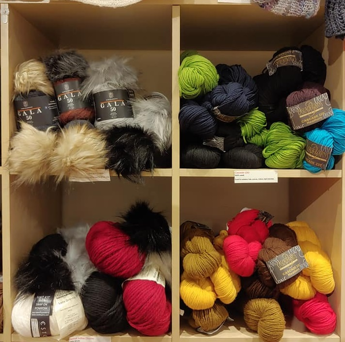 Four Shelves of 100% Wool Yarn
